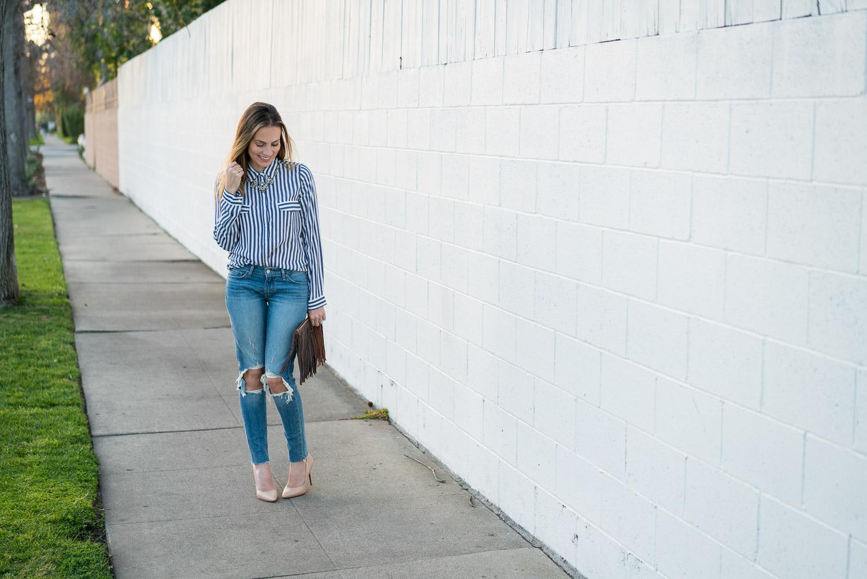 Distressed Levi's skinny jeans Zara striped top nude heels fringe clutch