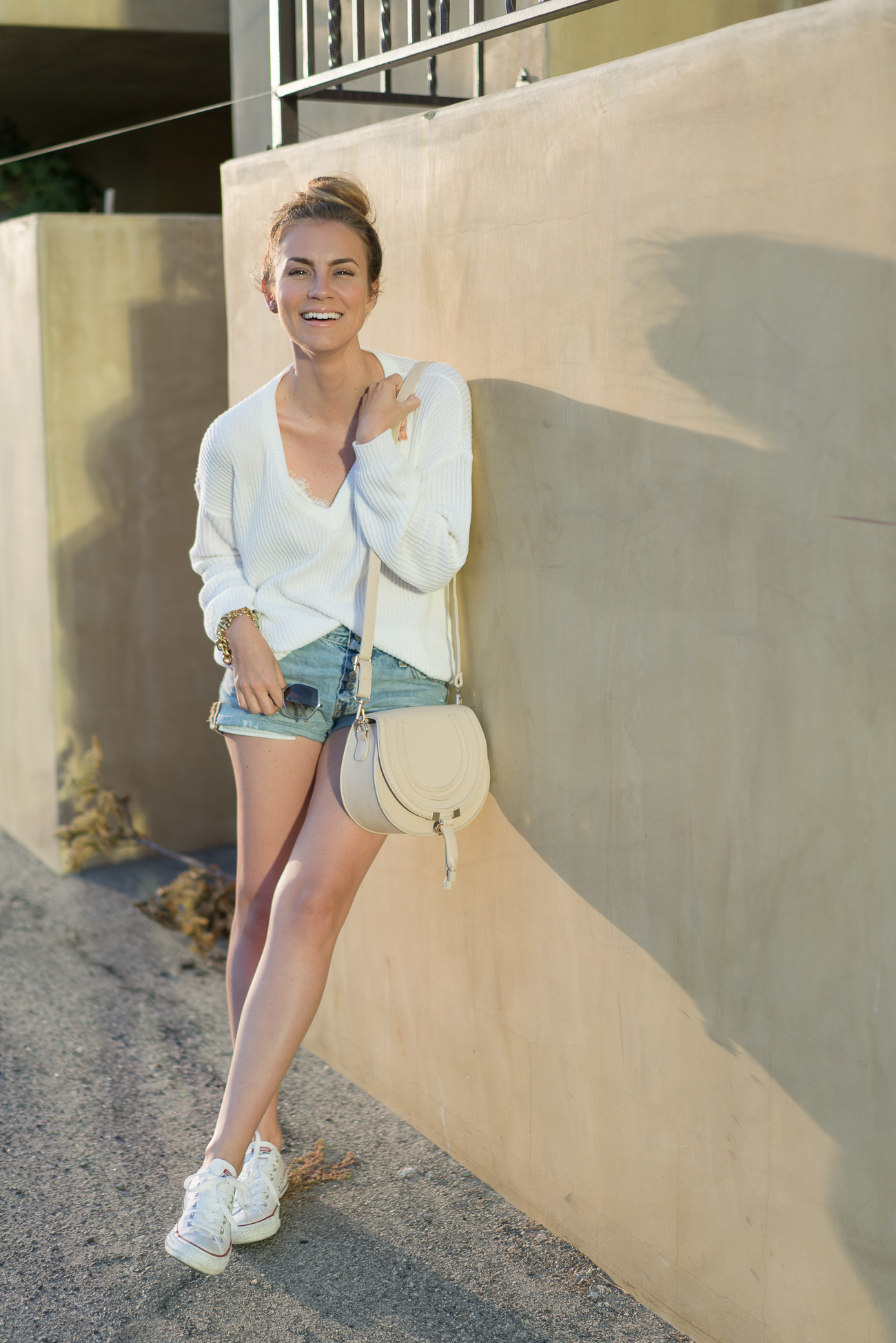 Brandy Melville Lance sweater, levi's 501 denim shorts, converse sneakers angela lanter hello gorgeous
