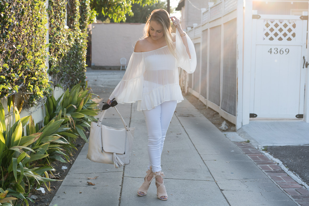 white off the shoulder top with ruffle trim white skinny jeans angela lanter hello gorgeous